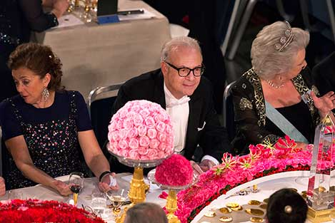 Patrick Modiano (middle), Princess Christina Mrs Magnuson (right) and Mrs Nathalie Tirole, spouse of Laureate in Economic Sciences Jean Tirole, at the table of honour at the Nobel Banquet, 10 December 2014.