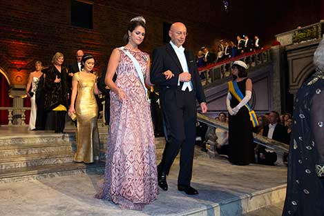 Sweden's Princess Madeleine and Stefan W. Hell proceed into the Blue Hall of the Stockholm City Hall for the Nobel Banquet.