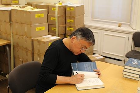 Kazuo Ishiguro signing books.