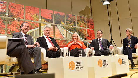 Elizabeth H. Blackburn, third from left, and 2006 Medicine Laureate Craig Mello, far left, discuss 'The Biology of Ageing' at the 2014 Nobel Week Dialogue, on 9 December 2014.
