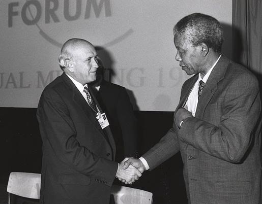 Nelson Mandela and Frederik de Klerk shake hands