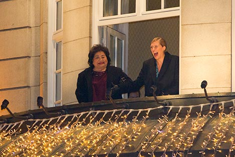 etsuko Thurlow and Beatrice Fihn viewing the traditional torch light procession.