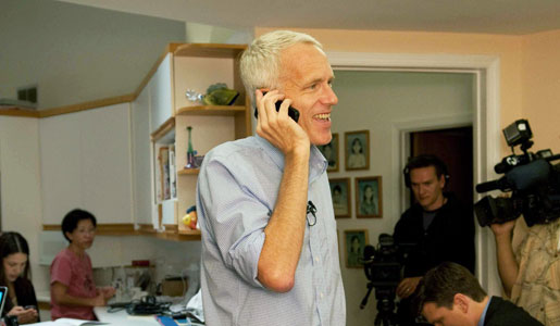 Brian K. Kobilka answers calls from reporters at his home immediately after the announcement of the Nobel Prize in Chemistry