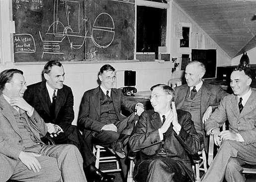 Meeting in the Radiation Laboratory at the University of California, Berkeley (UCB) in March 1940 to discuss the 184-inch cyclotron. From left: 1939 Physics Laureate Ernest  O. Lawrence, 1927 Physics Laureate Arthur H. Compton, Vannevar Bush, James B. Conant, Karl Compton, and Alfred Loomis.