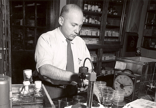 Joshua Lederberg at work in a laboratory at the University of Wisconsin