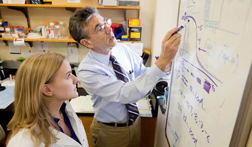 Robert J. Lefkowitz with student Erin Bressler
