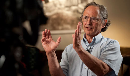 Michael Levitt speaks to reporters in his home, after the announcement of the Nobel Prize in Chemistry on 9 October