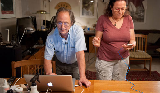 Michael Levitt and his wife, Rina, answer e-mails and phone calls from friends