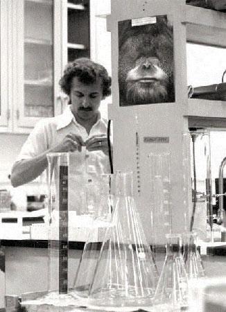Duke assistant professor doing an experiment.