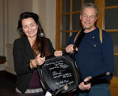 Like many Nobel Laureates before them, May-Britt and Edvard I. Moser autograph a chair at Bistro Nobel at the Nobel Museum in Stockholm, 6 December 2014