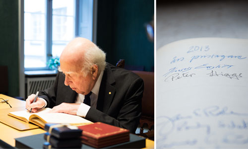 Peter Higgs visits the Nobel Foundation on 11 December 2013 and signs the guest book