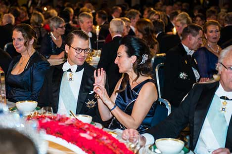 Sweden's Prince Daniel and May-Britt Moser in an animated discussion during the Nobel Banquet.