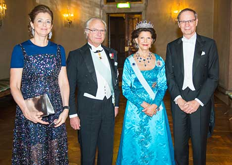 The Swedish Royal Family receive the Laureates and their significant others in the Prince's Gallery after the Nobel Banquet. From left to right: Mrs Nathalie Tirole, King Carl XVI Gustaf, Her Majesty Queen Silvia and Laureate Jean Tirole.