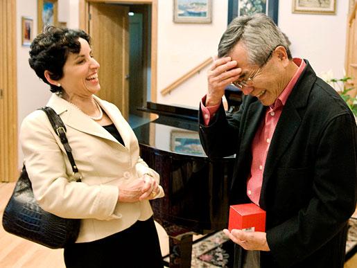 Professor Ei-ichi Negishi shares a joke with Purdue University President