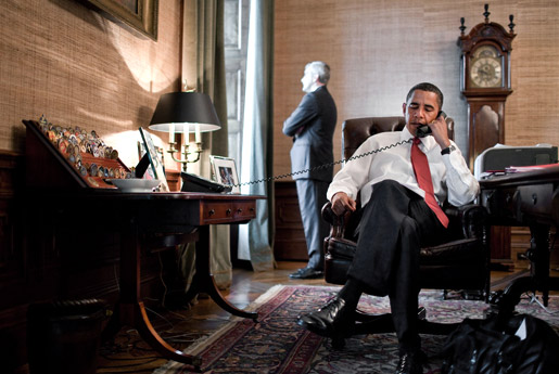 President Barack Obama on the phone in the office of the President's private residence in the White House
