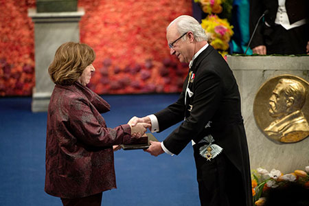 Svetlana Alexievich  receiving her Nobel Prize from H.M. King Carl XVI Gustaf of Sweden