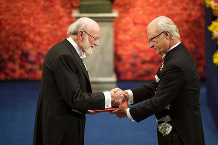 William C. Campbell  receiving his Nobel Prize from H.M. King Carl XVI Gustaf of Sweden