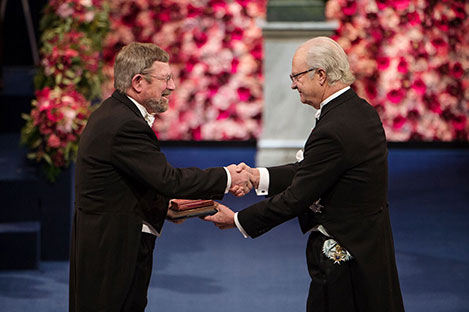 J. Michael Kosterlitz  receiving his Nobel Prize from H.M. King Carl XVI Gustaf of Sweden