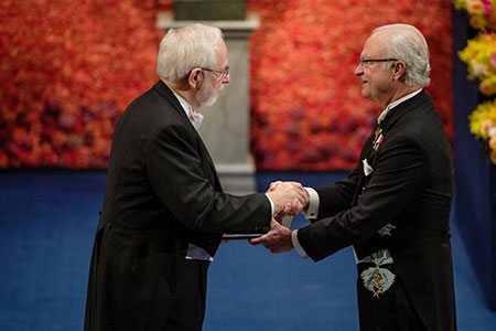Arthur B. McDonald receiving his Nobel Prize from H.M. King Carl XVI Gustaf of Sweden