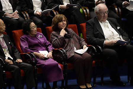 Nobel Laureates seated on stage. From left: Medicine Laureates Satoshi Ōmura and Youyou Tu, Literature Laureate Svetlana Alexievich and Laureate in Economic Sciences Angus Deaton.