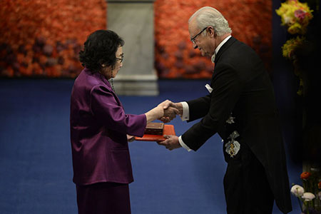 Youyou Tu  receiving her Nobel Prize from H.M. King Carl XVI Gustaf of Sweden