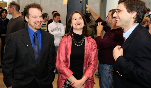 A happy Adam Riess, left, with his wife Nancy and colleague Dan Reich