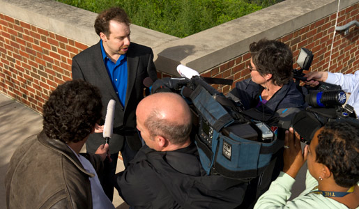Adam Riess, 2011 Nobel Laureate in Physics, surrounded by reporters and news media outside Johns Hopkins University.
