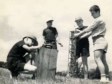 The author, second from the right, preparing to launch a model rocket, age 12. I was entranced by mathematics, physics, and technology.
