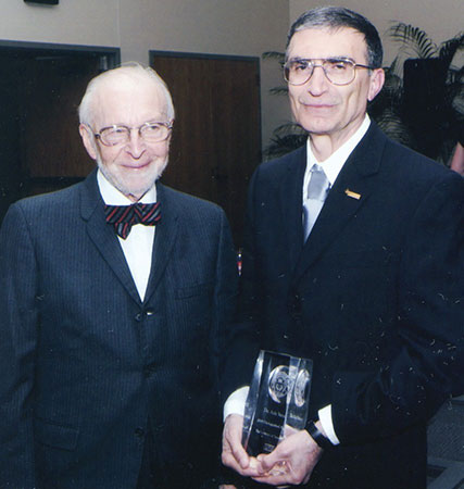 Aziz with his Ph.D. mentor Claud Rupert