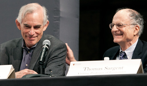 Princeton University economist Christopher Sims (left) enjoys a laugh during a news conference with his co-Laureate Thomas Sargent