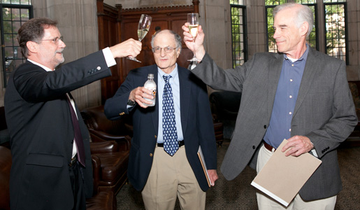 From left, Mark Watson, acting chair of Princeton University's economics department, salutes Thomas J. Sargent and Christopher A. Sims