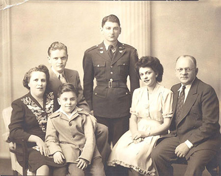 The Schekmans of St. Paul. Left to right: Rose, Alfred, Arthur (in front), Bill Feinberg, Helen and Norman.