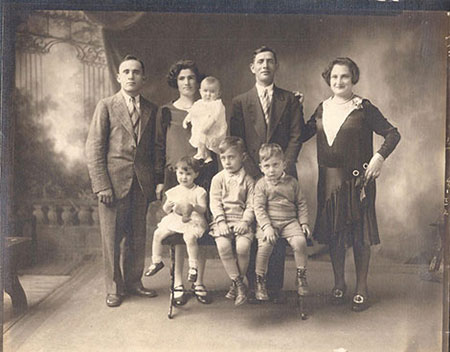 The Bader Family. From left: Raymond, Ida holding Esther, Mary seated to left.