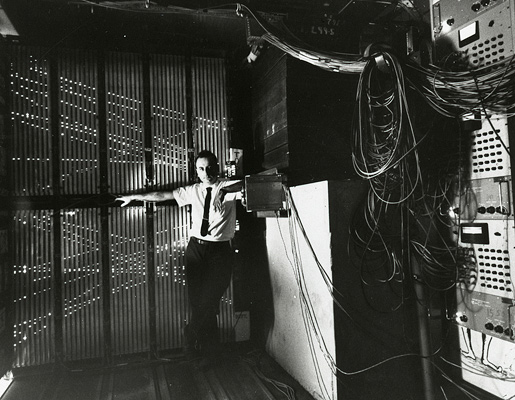 Melvin Schwartz in front of a spark chamber