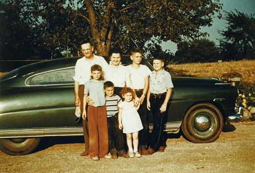 I am standing next to my father and mother who are on my right and my brother Dick, on my left. In the front are Mary, Bill and Sally (left to right), in about 1952.