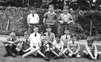 Kneeling in the middle of the middle row with 11 of my Melville College classmates on my 11th birthday.
