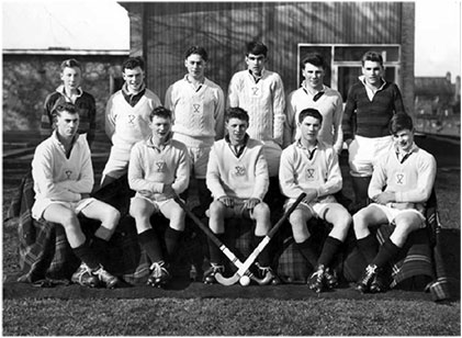 Third from the left in the back row of the 1960 First Hockey Eleven.