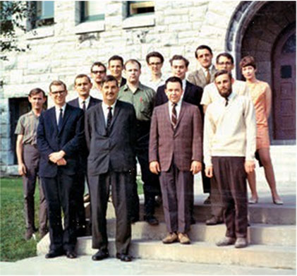 Second on the right in the third row back with Walter Szarek and Ken Jones at the front taken at Queen's University in Canada.