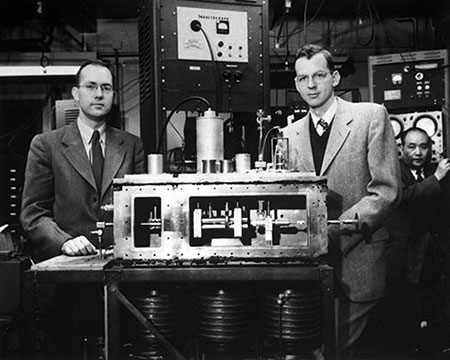 Charles H. Townes (left) and James P. Gordon shown with the second of two microwave amplifiers, or masers, that they built in 1955 with H. J. Zeiger (not shown).  Courtesy: The American Physical Society.