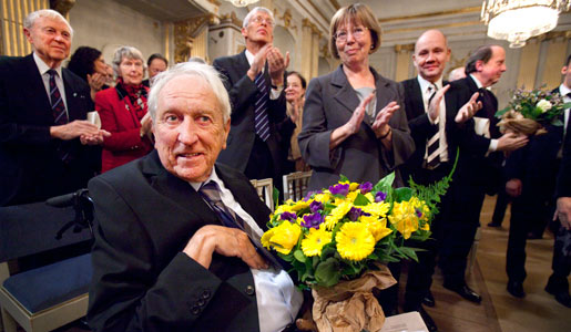 Tomas Tranströmer receives applause after the program at the Swedish Academy