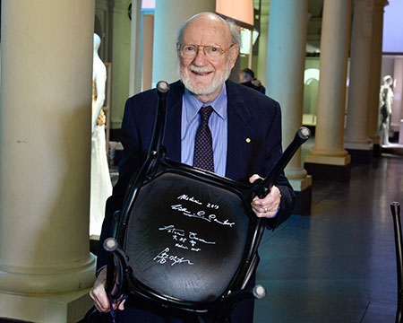 Nobel Laureate William C. Campbell and the autographed chair at the Nobel Museum in Stockholm.