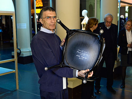 Nobel Laureate Aziz Sancar and the autographed chair at the Nobel Museum in Stockholm.