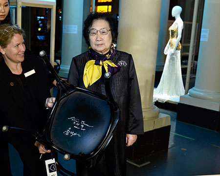 Nobel Laureate Youyou Tu and the autographed chair at the Nobel Museum in Stockholm.