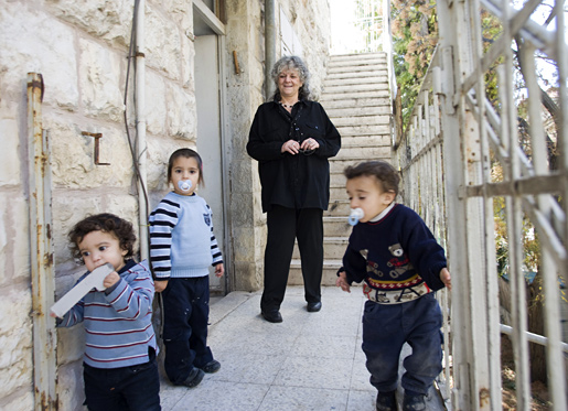 Professor Ada Yonath in the stairs of the house where she spent her childhood in a suburb of Jerusalem.