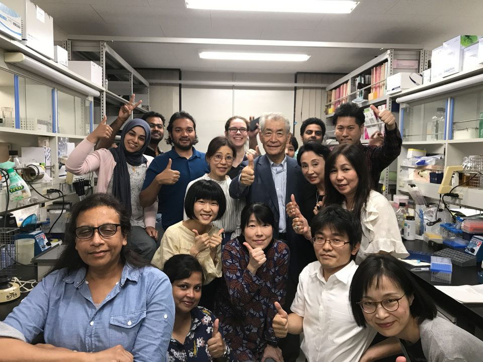 Nobel Laureate Tasuku Honjo, surrounded by his team at Kyoto University