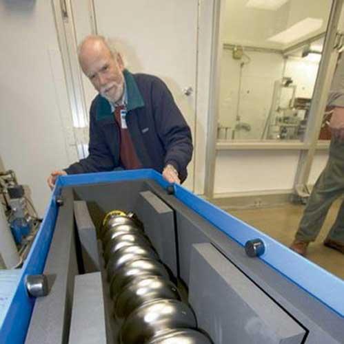 Inspecting superconducting cavities.