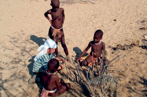 Joe with Himba friends in Namibia