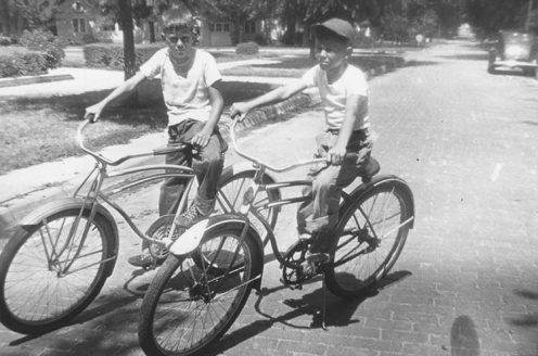 Bob and Chuck Wilson on bikes